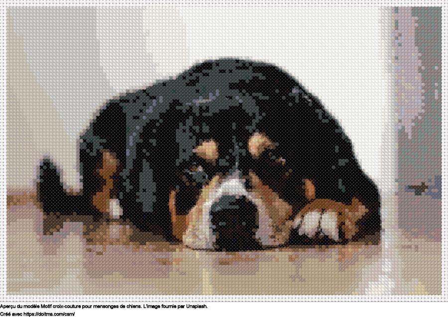 Motif de point de croix mensonges de chiens gratuit
